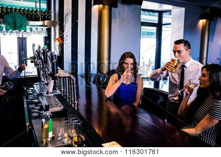 Friends having a drink in a bar