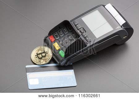 Bitcoin,credit card and POS-terminal.business concept