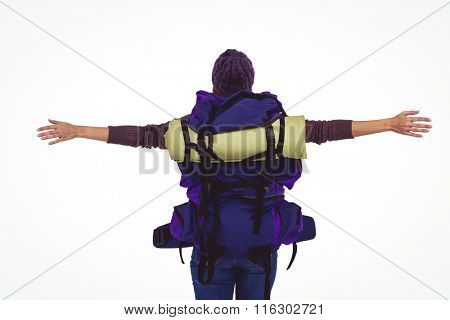 Rear view of a hipster woman with arms outstretched against white background