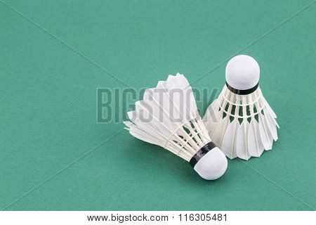 Two New Badminton Shuttlecock  On Green Court Mat