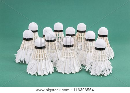 Group Of Used And Worned Out Badminton Shuttlecock On Green Court