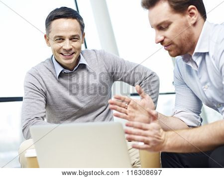 Corporate People Discussing Business In Office