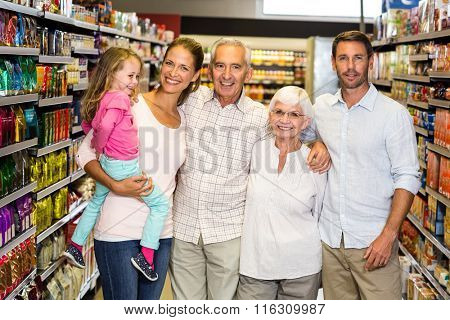 Portrait of happy extended family at the supermarket