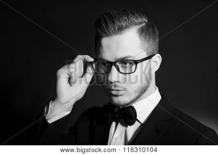 Handsome stylish young man. Brutal man with a beard and sunglasses.