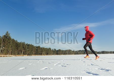 Trail runner sportsman in winter outdoor
