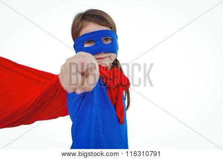 Masked girl pretending to be superhero pointing the camera on white screen
