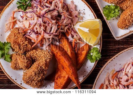 Homemade Cooked ?hicken Nuggets, Sweet Potatoes And Coleslaw.