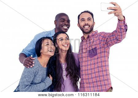 Happy multi-ethnic friends taking selfie while standing against white background