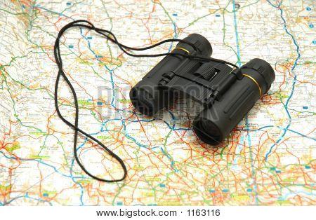 Binoculars Over The Map Of Uk