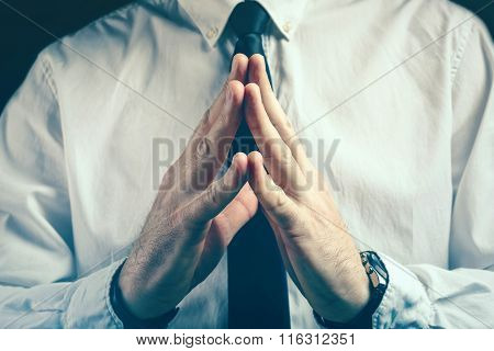 Confident Businessman Steepleing Gesture