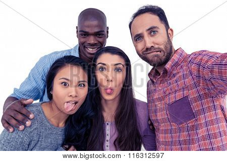 Portrait of happy multi-ethnic friends making face against white background