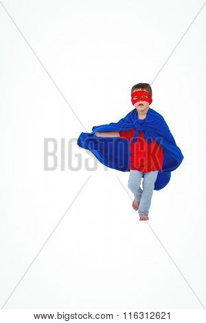 Masked boy running pretending to be superhero on white screen