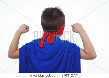 Rear view of masked boy pretending to be superhero on white screen