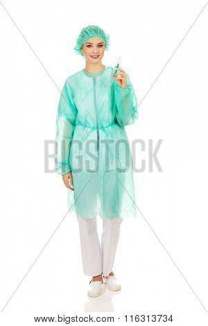 Female doctor holding a syringe.