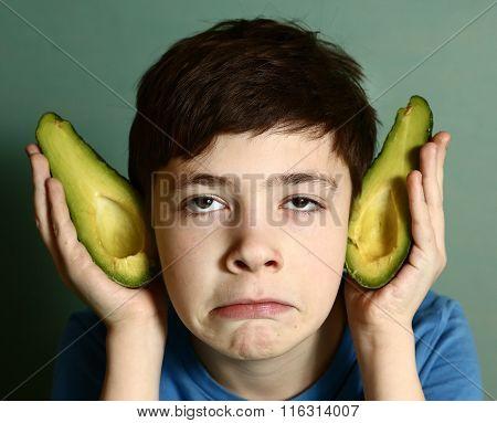 Cute Preteen Boy Performing Elf With Avocado Half