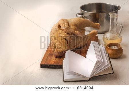 A Book With A Blank Page On A Background Of Raw Goose Carcasses