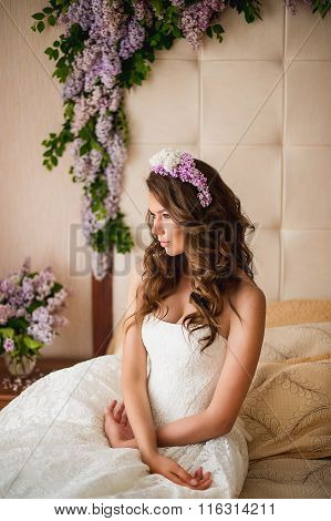 The Bride On A Bed With A Lilac