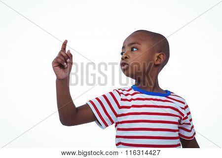 Cute boy shaking finger saying no on white screen