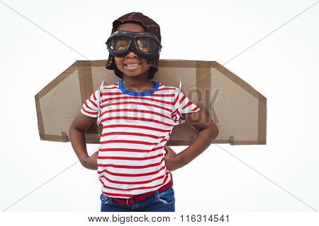 Smiling boy pretending to be pilot on white screen