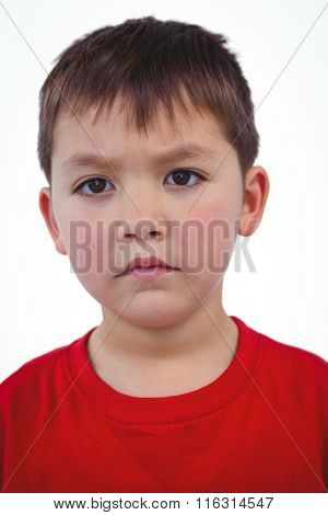 Portrait of unsmiling boy looking at camera on white screen