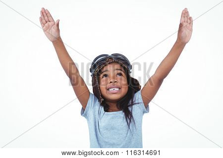Cute girl with arms outstretched pretending to be pilot