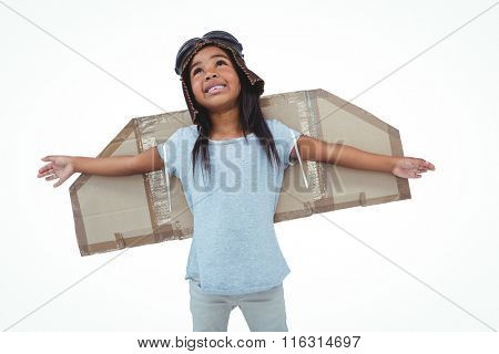 Girl with fake wings pretending to be pilot on white screen