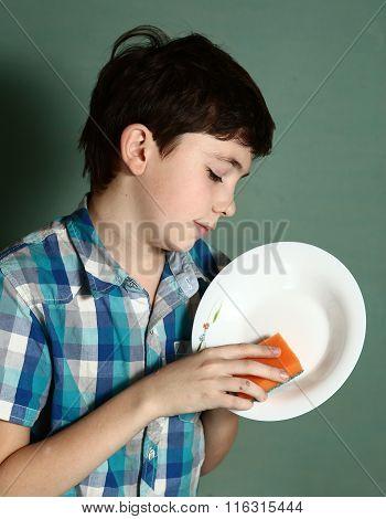 Happy Preteen Boy Wash Dishes Close Up Portrait