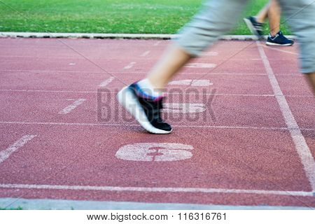 Runners Feet In Motion On Track