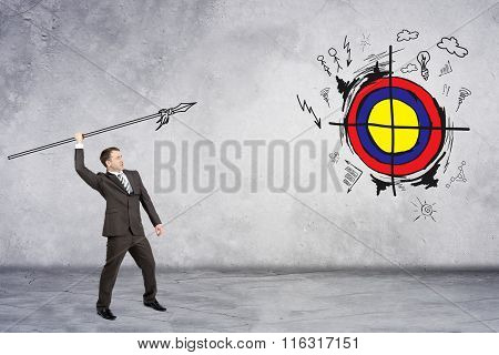 Businessman throwing spear to darts