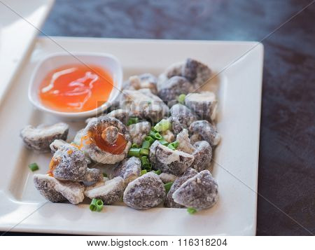 Fried Chinese Mushrooms With Sauce. Thai Style Native Food.