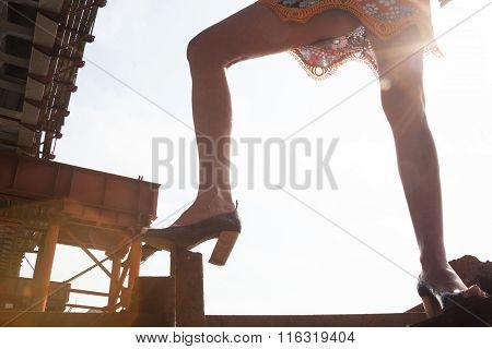 Woman Legs Against The Sunshine