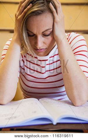 Busy female student studying at the university