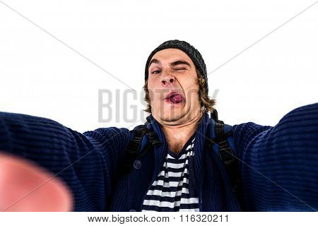 Hipster holding camera and grimacing on white screen