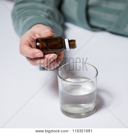 Woman Dripping Medicated Drops
