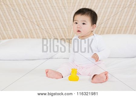 Cute baby on bed looking around