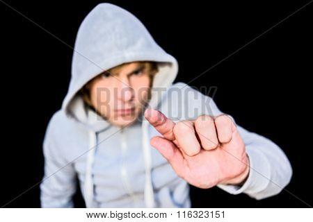 Man in hood jacket on black background