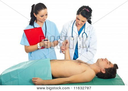 Doctor Taking Pulse To Male Patient