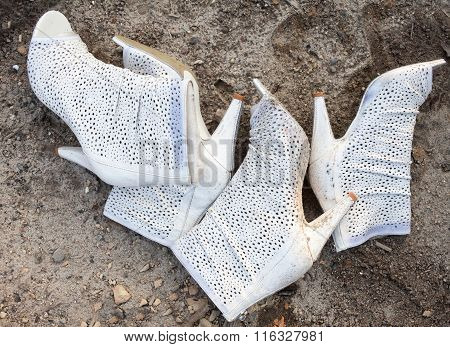 White High Heel Shoes Thrown Away