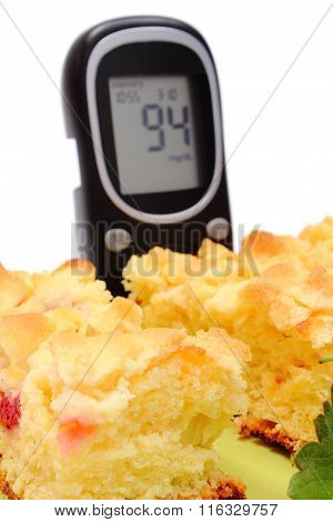 Pieces Of Yeast Cake With Strawberries And Glucometer
