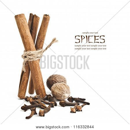 cloves and cinnamon sticks on white
