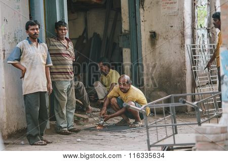 KOLKATA, INDIA - APRIL 12, 2013: Unqualified indian craftsman work without observing safety measures
