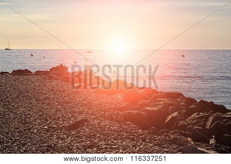 Fisherman Sitting At Sunset