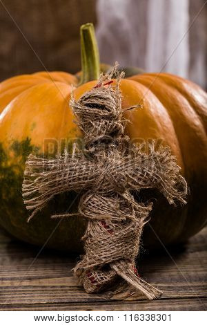 Burlap Doll Near Pumpkin
