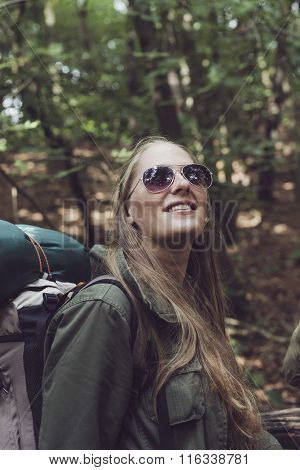 Trekking Woman In Forest Enjoying Nature.