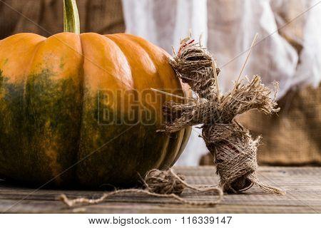 Burlap Voodoo Doll Near Squash