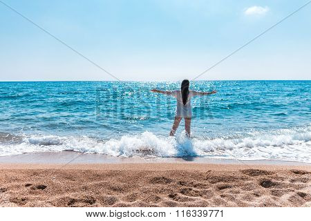 beautiful greek young brunet woman on beach in white dress