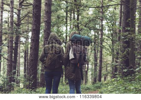 Friends With Hoody Walking On Forest Trail.