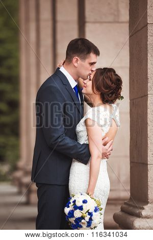 Happy bride and groom celebrating wedding day, kissing married couple