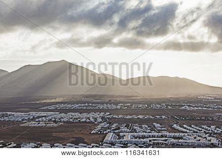 View Over Playa Blanca In Morning Light With Mountains