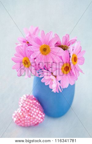 Daisies in a blue vase